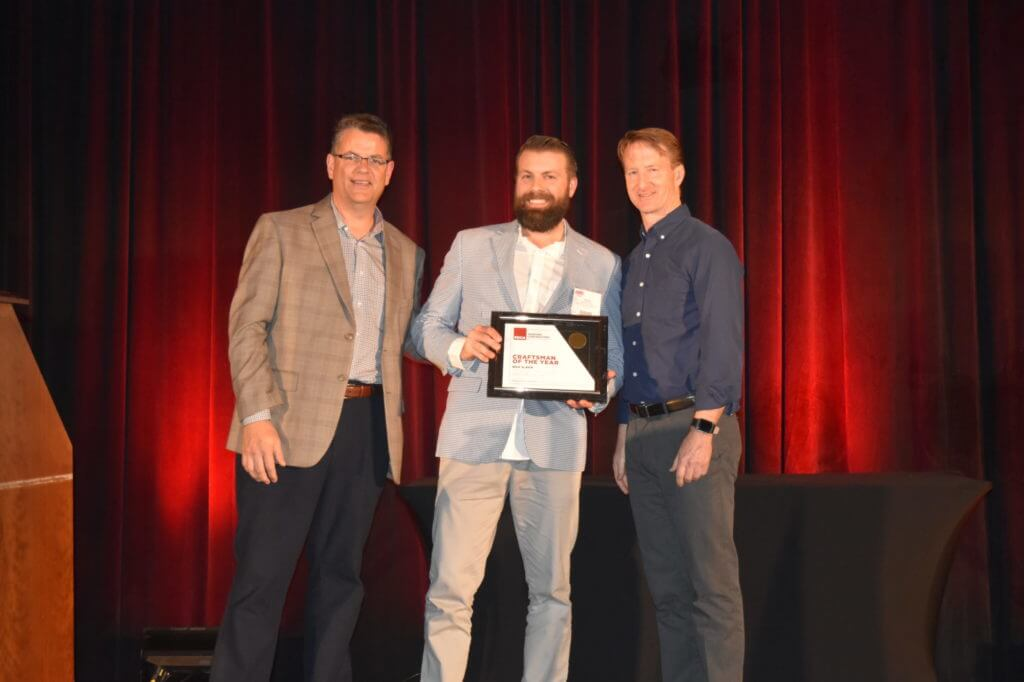 professional painter Nick Slavik accepting the PDCA's Craftsman of the Year with Nigel Costolloe