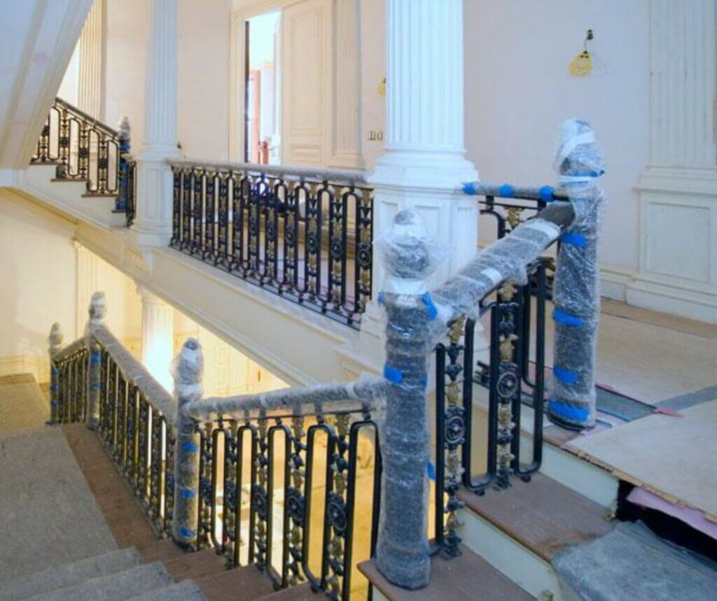magnificently detailed wrought iron railing protected
